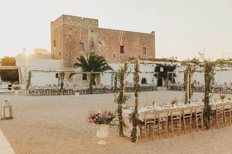 Outdoor Wedding Reception with Vines | Brightly Coloured Destination Wedding at Masseria Potenti Wedding Venue, Puglia, South Italy | Petar Jurica Photography | Marco Odorino Film