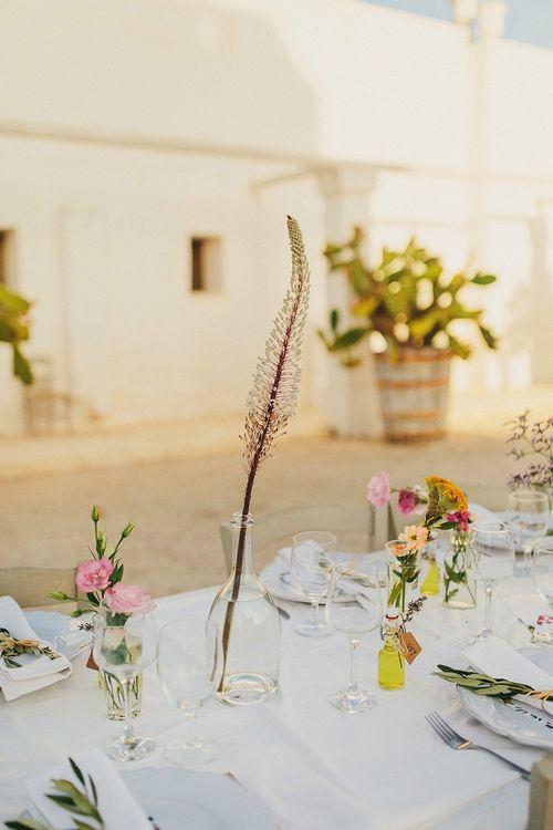 Wild Flower Stems in Vases | Wedding Decor | Brightly Coloured Destination Wedding at Masseria Potenti Wedding Venue, Puglia, South Italy | Petar Jurica Photography | Marco Odorino Film