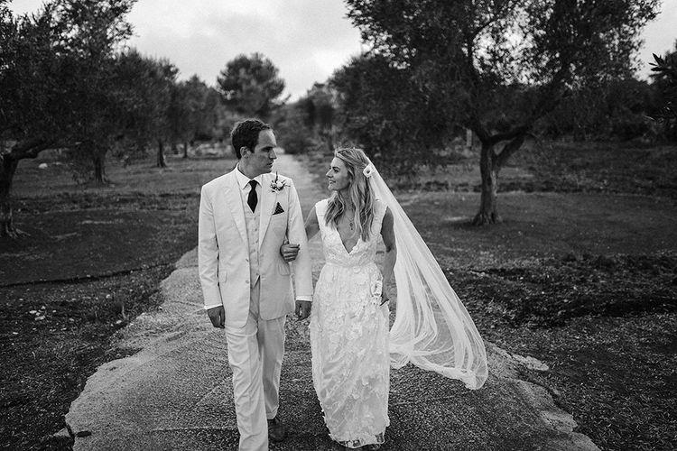Bride in Custom Clemence Halfpenny London Bridal Gown | Groom in Cream Three Piece Suit | Brightly Coloured Destination Wedding at Masseria Potenti Wedding Venue, Puglia, South Italy | Petar Jurica Photography | Marco Odorino Film