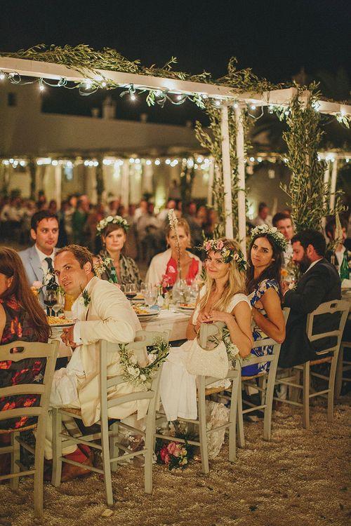 Outdoor Wedding Reception with Fairy Lights | Brightly Coloured Destination Wedding at Masseria Potenti Wedding Venue, Puglia, South Italy | Petar Jurica Photography | Marco Odorino Film