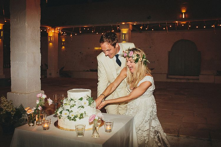 Cutting the Cake | Bride in Custom Clemence Halfpenny London Bridal Gown | Groom in Cream Three Piece Suit | Brightly Coloured Destination Wedding at Masseria Potenti Wedding Venue, Puglia, South Italy | Petar Jurica Photography | Marco Odorino Film