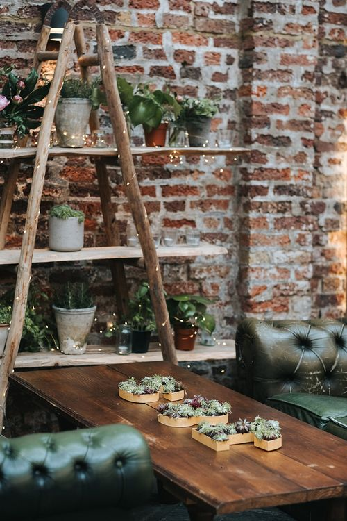 Wooden Retro Ladder Shelving Display with Pot Plants and Fairy Lights | Succulents in Initial Shaped Vases | Leather Sofas | Victoria Stakes Pub Wedding Reception | High Street Wedding Dress for an Intimate Crouch End Pub Wedding with Bright Flowers | Miss Gen Photography