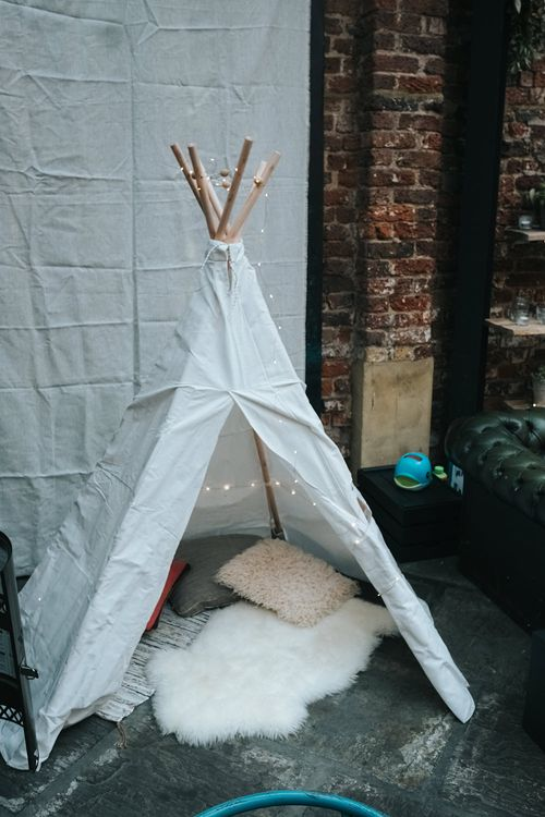 White Teepee with Cushions, Rugs and Fairy Lights | Victoria Stakes Pub Wedding Reception | High Street Wedding Dress for an Intimate Crouch End Pub Wedding with Bright Flowers | Miss Gen Photography