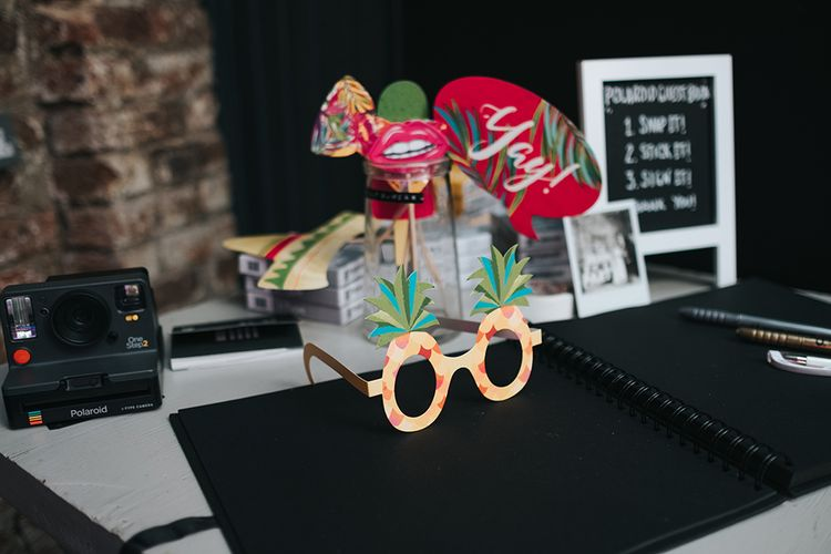 Polaroid Photobooth with Props and Guestbook | Victoria Stakes Pub Wedding Reception | High Street Wedding Dress for an Intimate Crouch End Pub Wedding with Bright Flowers | Miss Gen Photography