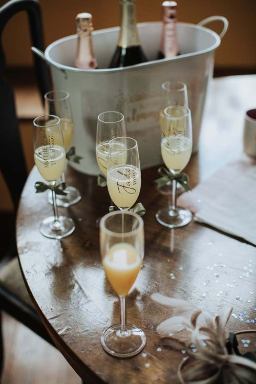 Personalised Champagne Glasses For Marquee Wedding With Floral Backdrop