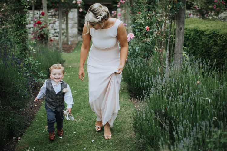 Bridesmaid Accompanies Child At Wedding