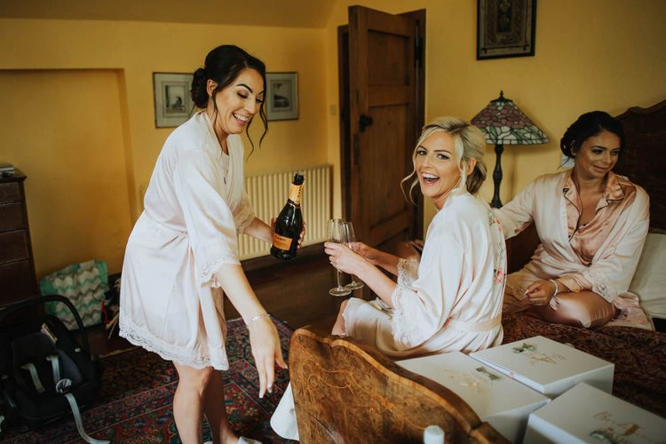 Bridesmaids Get Ready For Nettlestead Place Wedding With Floral Backdrop