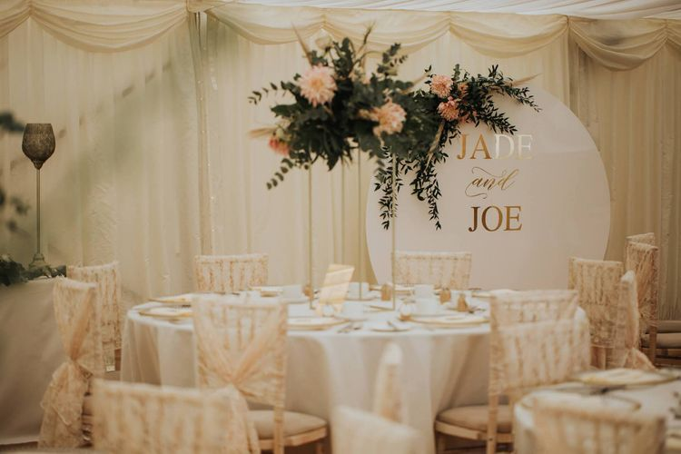 Wedding Table Set Up For Marquee Reception With Large Wedding Sign