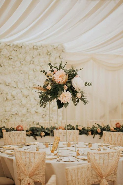 Pink And White Wedding Flower Centrepieces With Floral Backdrop