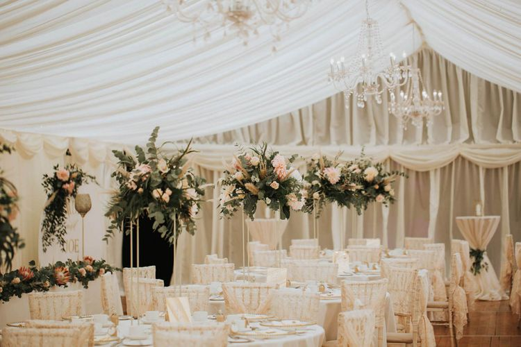 Beautiful Blush Wedding Table Set Up In Marquee With Floral Backdrop