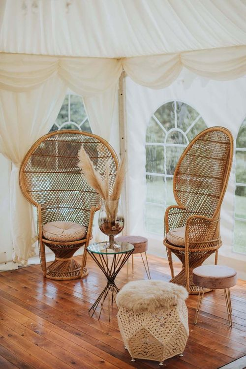 Peacock Chairs and Pampas Grass at Wedding With Floral Backdrop