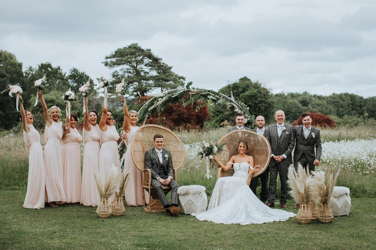Wedding Party Strike A Pose On Peacock Chairs With Pampas Grass Decor