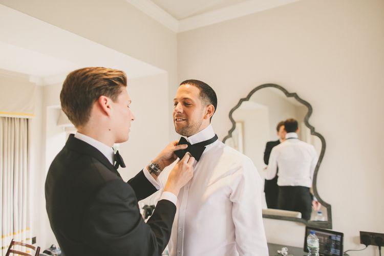 Groom Helping His Husband Tie His Bow Tie on the Wedding Morning