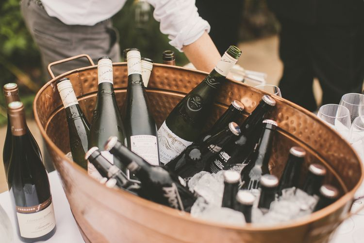 Wedding Reception Drinks with Bottles on Wine on Ice
