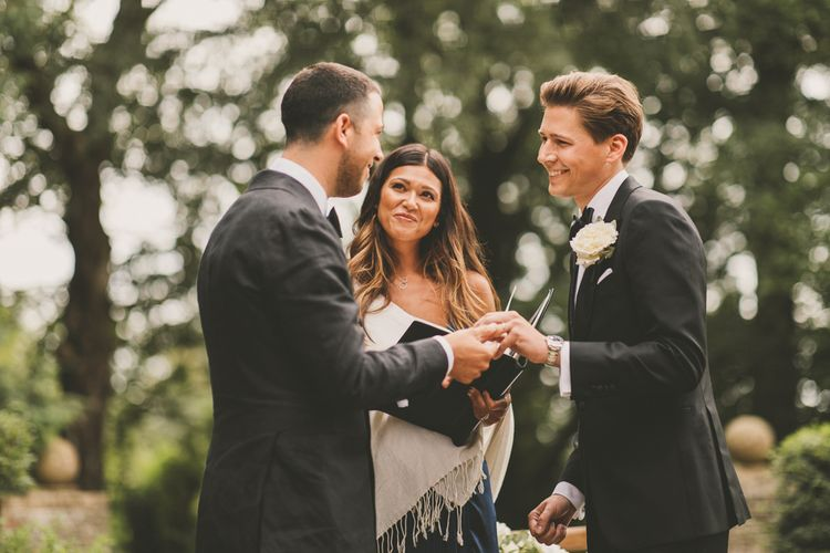 Groom and Groom Exchanging Vows at Worcestershire Wedding Venue Foxhill Manor