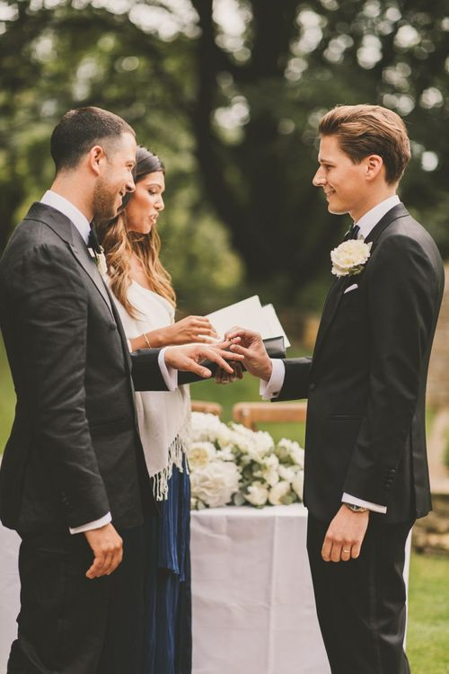 Groom and Groom Exchanging Rings  at Worcestershire Wedding Venue Foxhill Manor