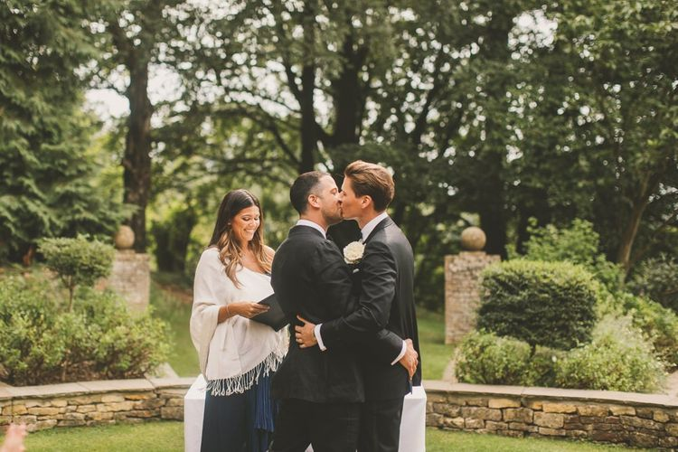 Groom and Groom Kissing  at Outdoor Wedding Ceremony at Worcestershire Wedding Venue Foxhill Manor
