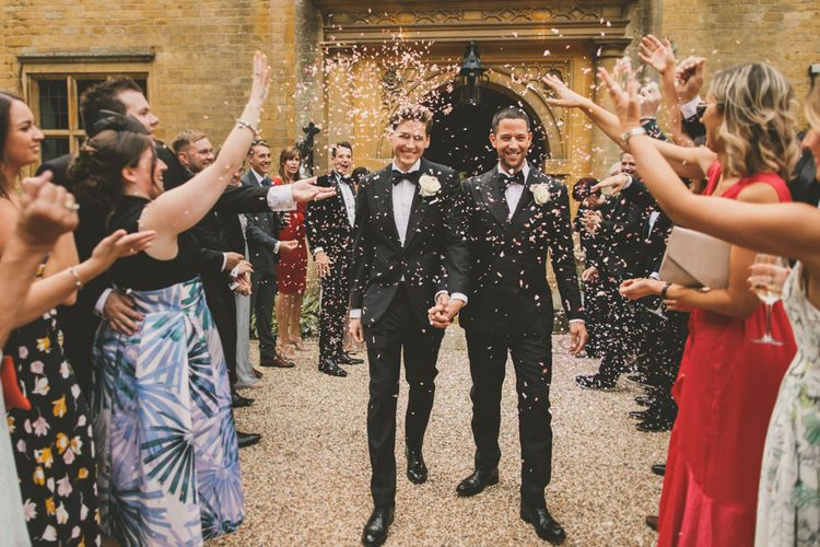 Confetti Moment with Grooms in Black Tie Suits at Worcestershire Wedding Venue