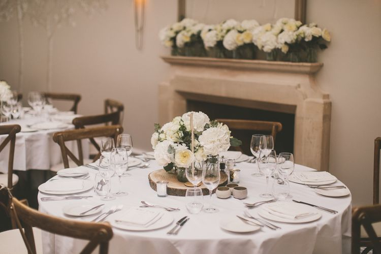 White Flower Centrepiece and Fireplace Flowers with Hydrangeas and Roses at Worcestershire Wedding Venue
