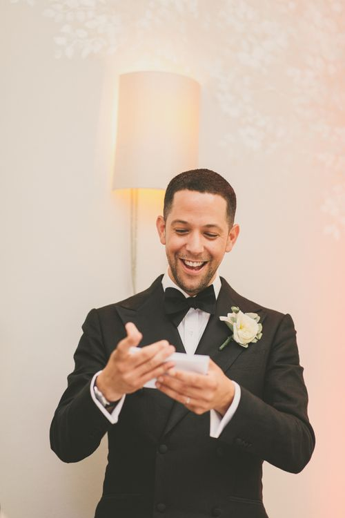 Groom in Tuxedo and Bow Tie Delivering His Wedding Speech