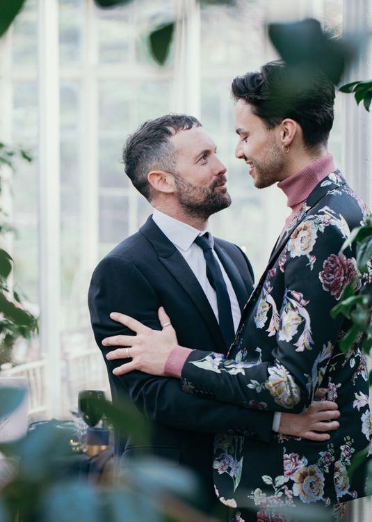 Groom in floral wedding suit