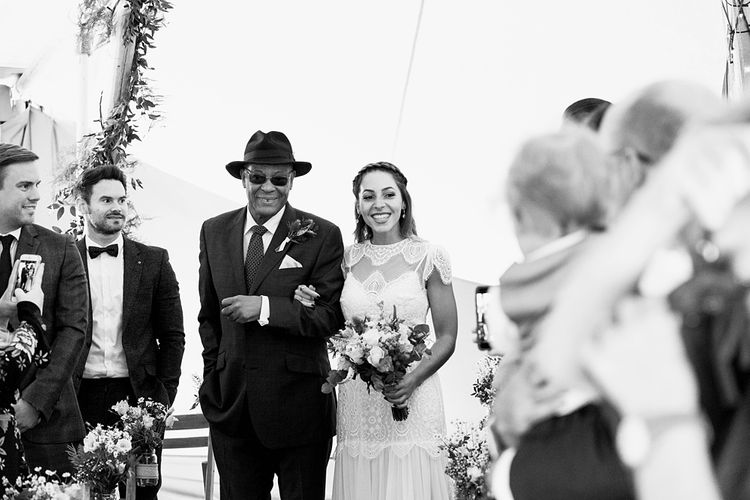 Entrance of the Bride | Laced KatyaKatya Wedding Dress with Cap Sleeves and Ribbon Belt | Floor Length Veil | Bridal Bouquet of Wild Flowers  with Lavender, Thistles, White Roses and Eucalyptus | Lace KatyaKatya Dress for Tipi Wedding at Fforest Farm | Claudia Rose Carter Photography