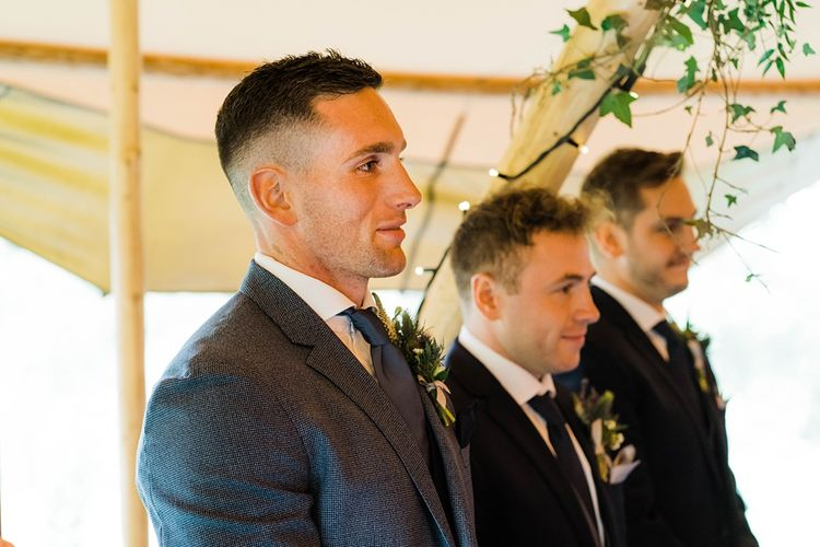 Wedding Ceremony | Groom in Blue T.M Lewin Suit with Navy Hawkes Bespoke Outfitters Waistcoat | Groomsmen in Navy Moss Bros. Suits | Lace KatyaKatya Dress for Tipi Wedding at Fforest Farm | Claudia Rose Carter Photography