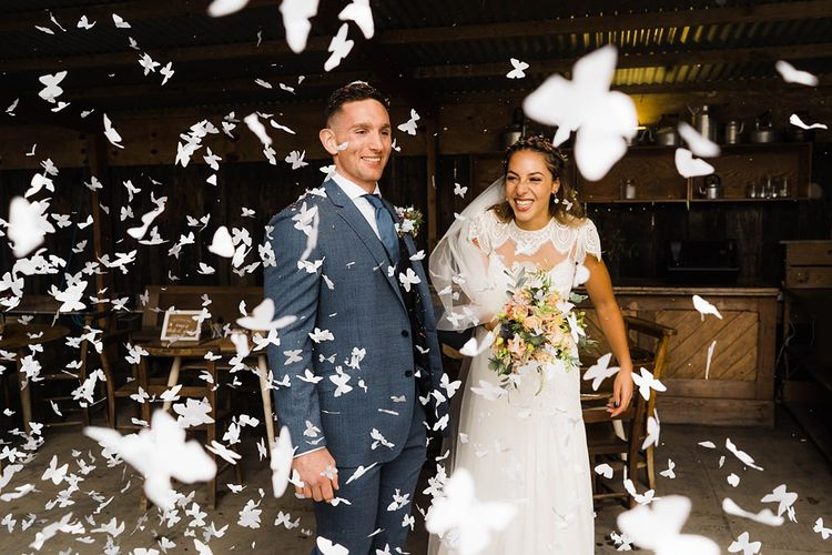 Confetti Cannon | Bride in Laced KatyaKatya Wedding Dress with Cap Sleeves and Ribbon Belt | Groom in Blue T.M Lewin Suit with Navy Hawkes Bespoke Outfitters Waistcoat | Bridal Bouquet of Wild Flowers  with Lavender, Thistles, White Roses and Eucalyptus | Lace KatyaKatya Dress for Tipi Wedding at Fforest Farm | Claudia Rose Carter Photography