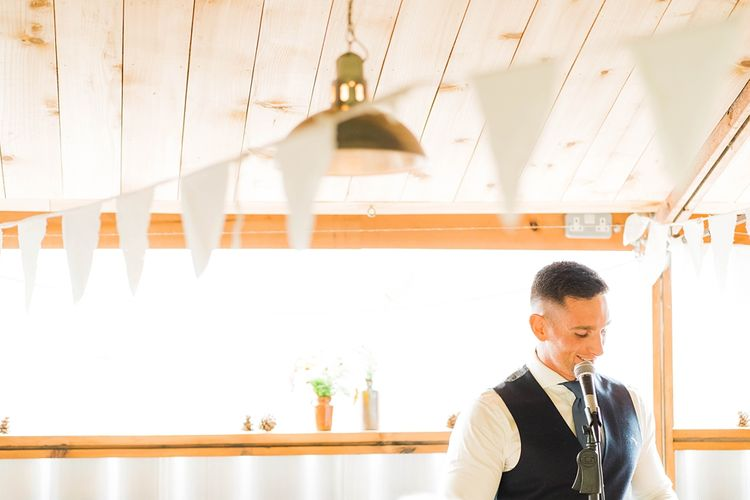 Groom's Speech | Groom in Blue T.M Lewin Suit with Navy Hawkes Bespoke Outfitters Waistcoat | Lace KatyaKatya Dress for Tipi Wedding at Fforest Farm | Claudia Rose Carter Photography