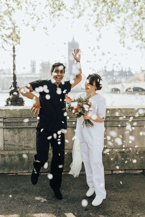 NHS Dr Annalan Navaratnam and Nurse Jann Tipping marry in the chapel of Guys and St Thomas Hospital in London amid Coronavirus pandemic by Rebecca Carpenter