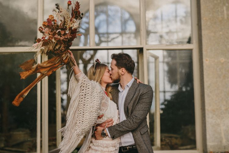 Boho Bride in Sara Lage Wedding Dress and Crochet Wrap and Groom in Vintage Grey Blazer Just Married