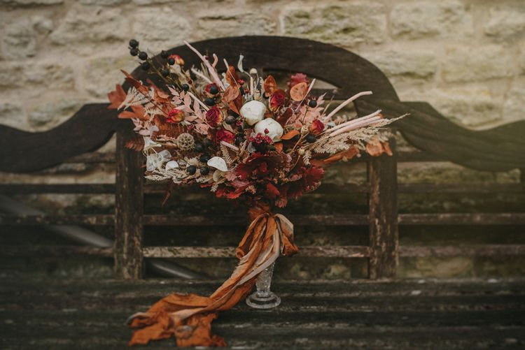 Dried Red and Orange Wedding Bouquet Tied with Ribbon