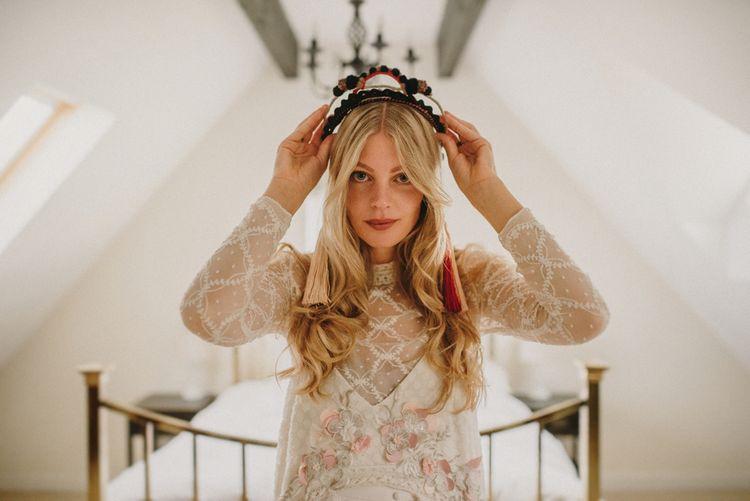 Boho Bride Putting on Her Verbena Madrid Headdress