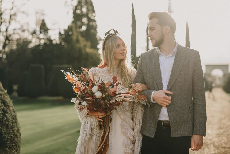Golden Hour Moment with Bride in Sara Lage Wedding Dress  and Wool Shawl and Groom in Grey Wool Blazer