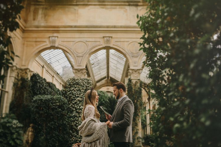 Boho Bride and Groom Exchanging Vows at their Orangery Elopement