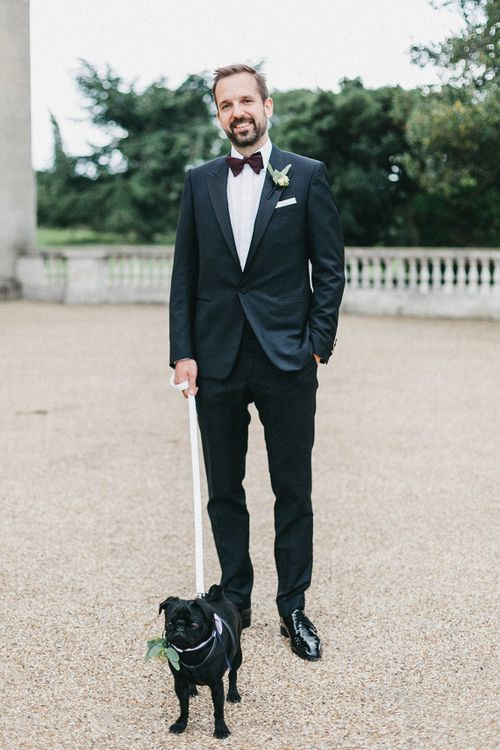 Groom in Navy Lanvin Tuxedo and Black Burberry Shoes | Burgundy Bow Tie | Paul the Pug | Stunning Syon Park Wedding with Quill Stationery Suite | Nancy Ebert Photography