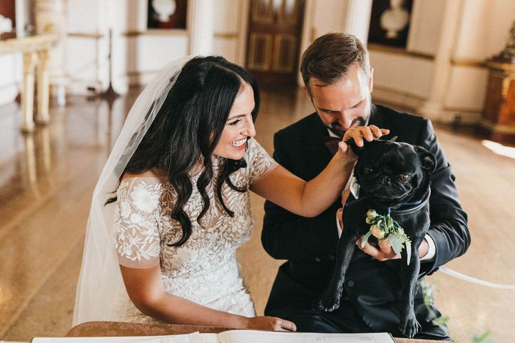 Signing of the Register | Bride in Hermione de Paula Wedding Gown with Short Sleeves and Personalised Embroidery | Cathedral Veil | Groom in Navy Lanvin Tuxedo and Black Burberry Shoes | Burgundy Bow Tie | Paul the Pug | Stunning Syon Park Wedding with Quill Stationery Suite | Nancy Ebert Photography