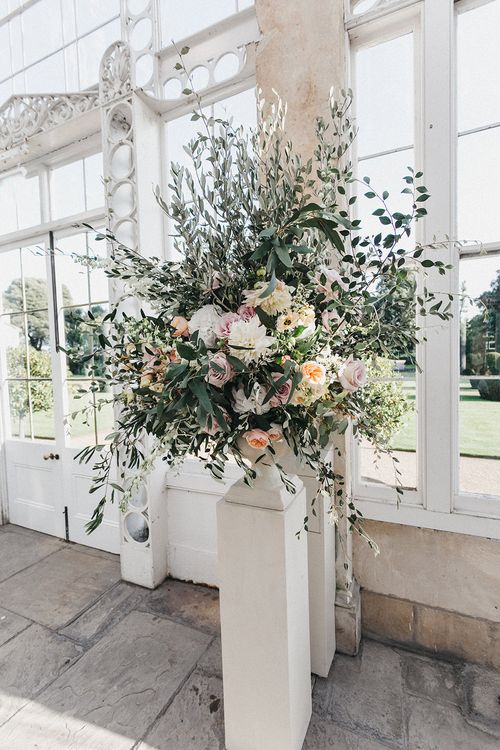 Wedding Reception Decor at Syon Park | Huge Urn of Cafe au Lait Dahlias, David Austin Roses, Hydrangeas, Delphinium, Cosmos, Eucalyptus and Olive | Stunning Syon Park Wedding with Quill Stationery Suite | Nancy Ebert Photography