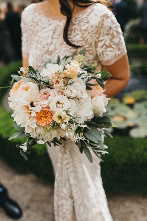 Blush, Cream and Pink Bridal Bouquet | Cafe au Lait Dahlias, David Austin Roses, Hydrangeas, Delphinium, Cosmos, Eucalyptus and Olive | Bride in Hermione de Paula Wedding Gown with Short Sleeves and Personalised Embroidery | Stunning Syon Park Wedding with Quill Stationery Suite | Nancy Ebert Photography