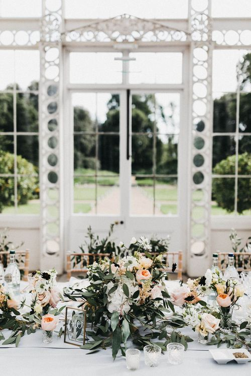 Wedding Reception Decor | Top Table | Blush, Cream and Pink Floral Centrepieces | Grey Tablecloth |  Gold Table Number | Stunning Syon Park Wedding with Quill Stationery Suite | Nancy Ebert Photography