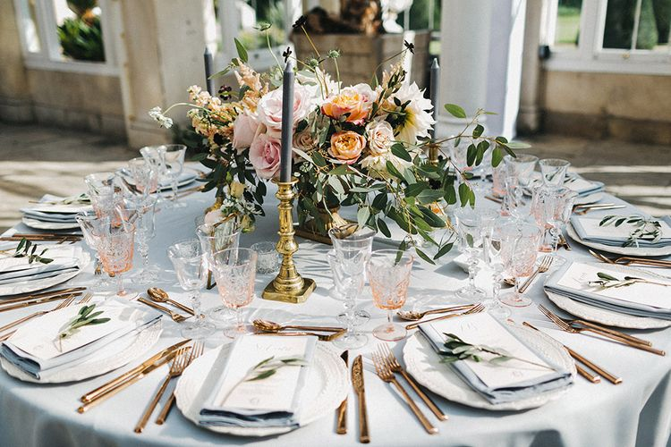 Wedding Reception Decor | Blush, Cream and Pink Floral Centrepiece | Grey Tablecloth | Gold Cutlery | Pink Goblets | Stunning Syon Park Wedding with Quill Stationery Suite | Nancy Ebert Photography