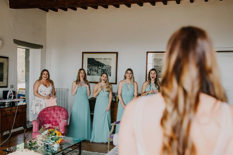 Bridesmaid dresses in mint green during bridal preparations
