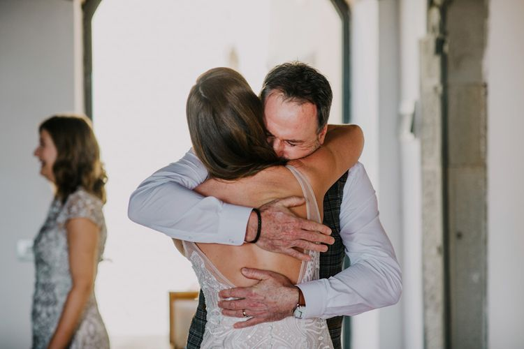 Father hugs bride before ceremony