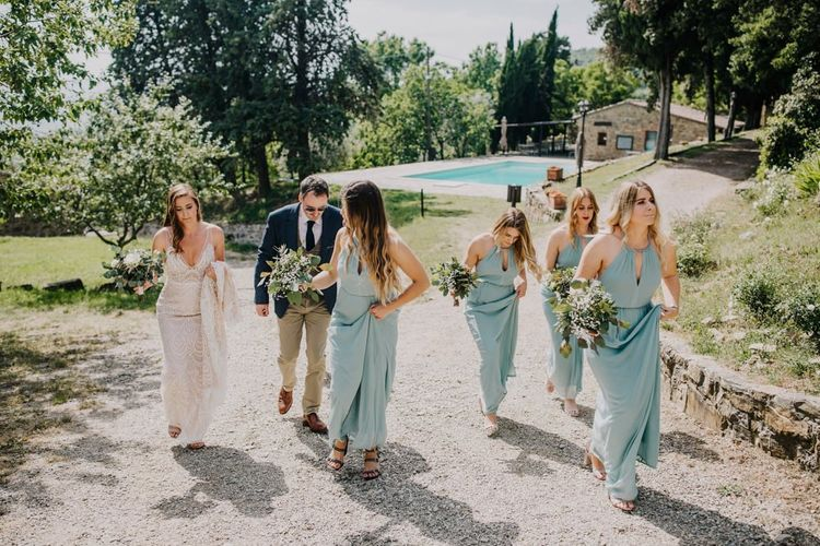 Bridesmaid dresses in mint green make their way to ceremony