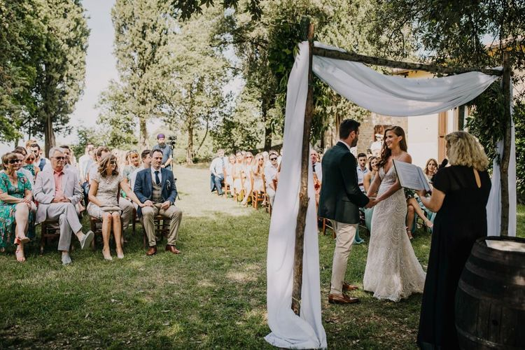 Bride and groom during outdoor wedding ceremony