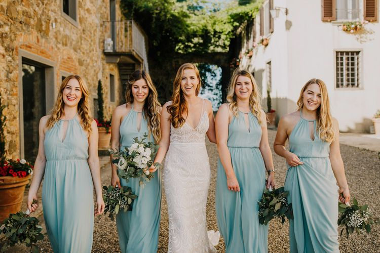 Bride with bridal party in bridesmaid dresses in mint green
