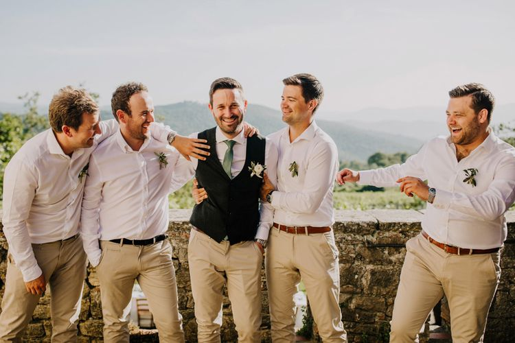 Groom with groomsmen in matching cream chinos