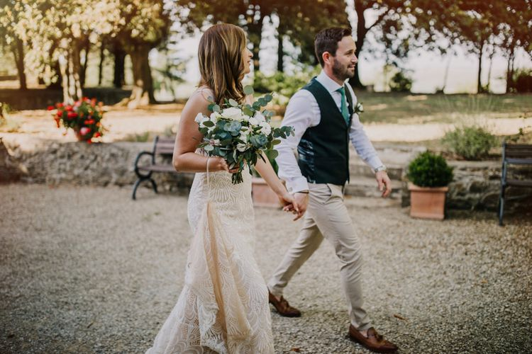 Bride carried foliage bouquet with white flowers
