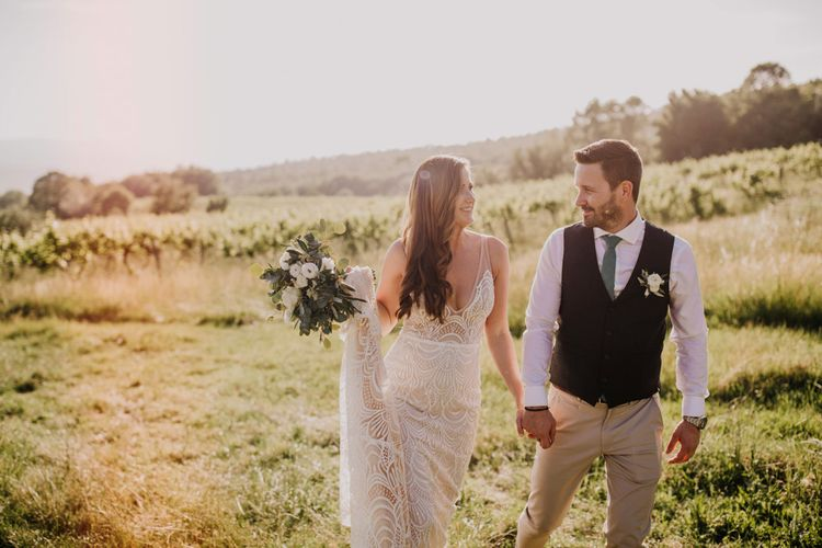 Bride and groom at Italian wedding with bridesmaid dresses in mint green