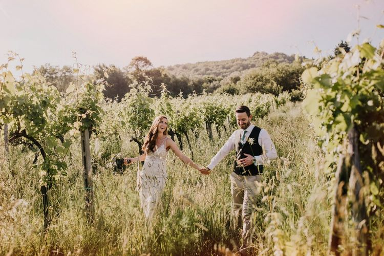 Bride and groom in the olive groves that inspired the bridesmaid dresses in mint green